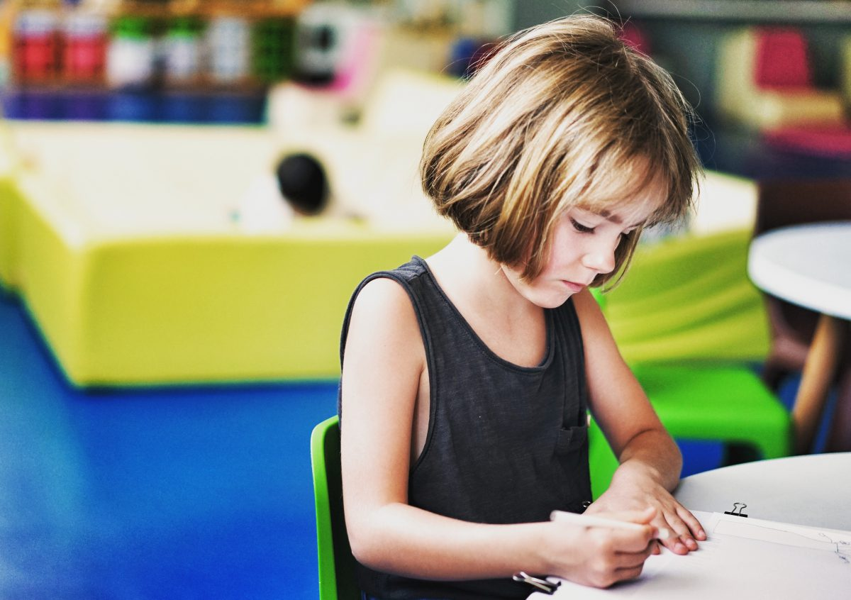 Girl writing at school