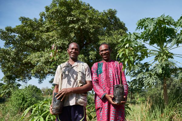 Trees for the Future in Senegal: Two farmers standing with their trees