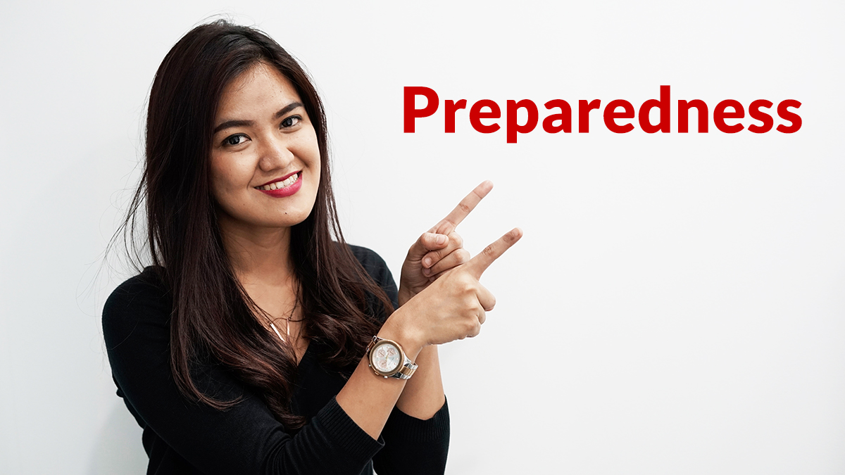 "Woman pointing at word ""Preparedness"""